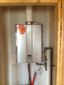 tankless hot water heater on wall